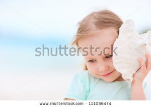 stock-photo-adorable-little-girl-with-seashell-at-the-beach-111056474